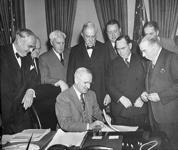 Truman_signing_act